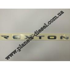 Эмблема REXTON